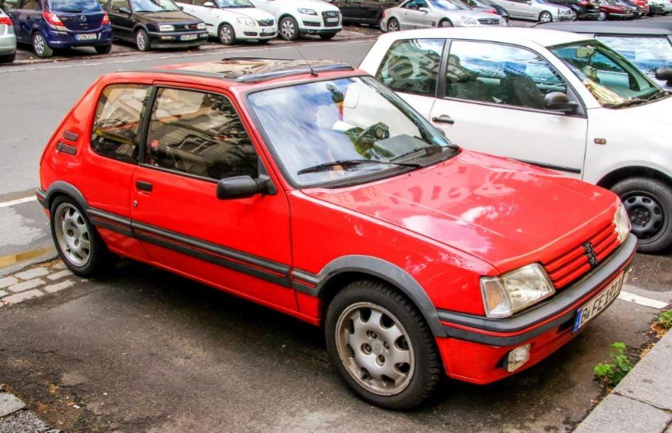 "alt="" Peugeot 205 rojo"""